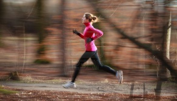 11940511-young-woman-running-outdoors-in-a-city-park-on-a-cold-fall-winter-day-motion-blurred-image
